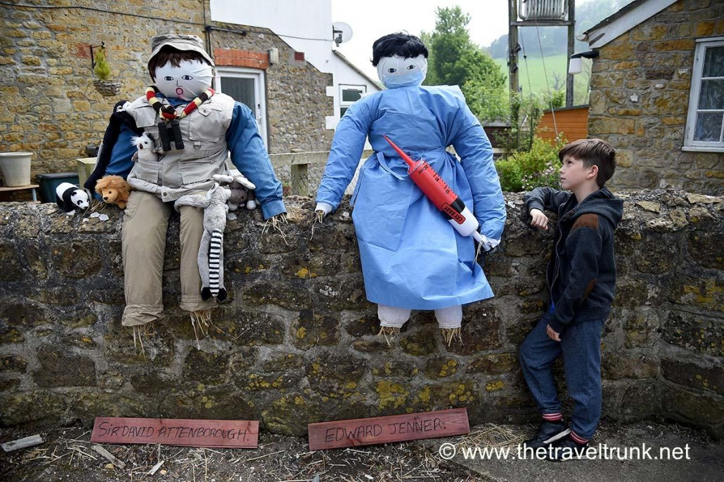 Scarecrows sitting on wall